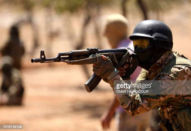 A Syrian fighter aims his AK47 rifle as he attends a mock battle in anticipation of an attack by the regime on Idlib province and the surrounding...