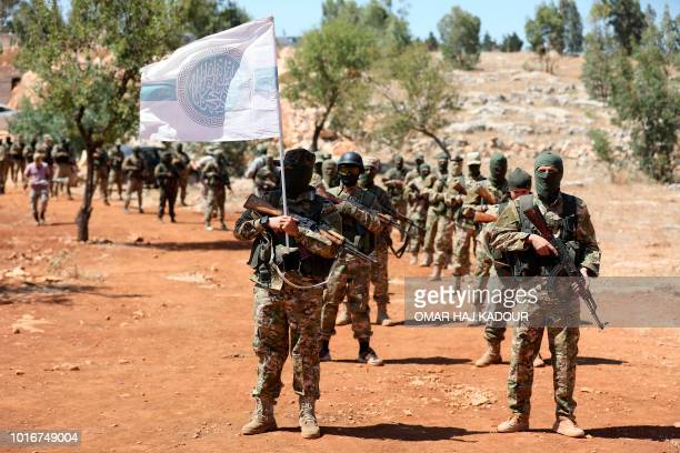 Syrian fighters attend a mock battle in anticipation of an attack by the regime on Idlib province and the surrounding countryside during a graduation...