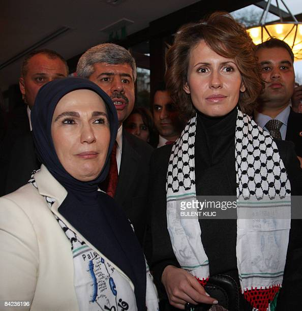 Syrian First Lady Asma alAssad chats with Emine Erdogan wife of Turkish Prime Minister Recep Tayyip Erdogan at a meeting of spouses of the heads of...