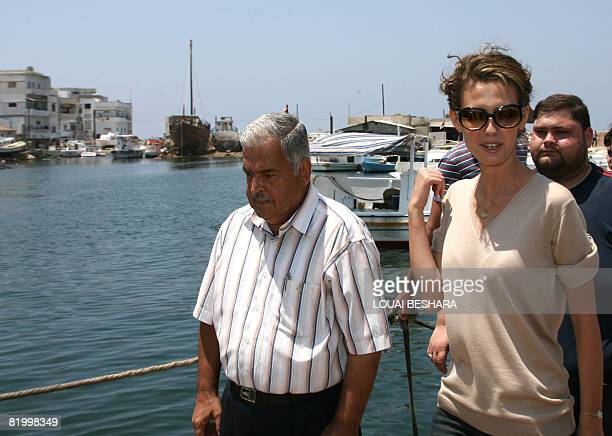 Syrian First Lady Asma alAssad gestures as she visits the harbour and 'workshop' where a Phoenician ship is being built on the Syrian Island of Arwad...