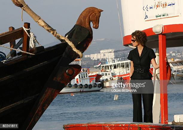 Syrian First Lady Asma alAssad inspects a replica of a Phoenician ship built on the Syrian island of Arwad some three kms off the coastal city of...