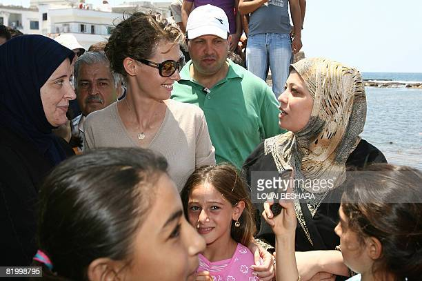 Syrian First Lady Asma alAssad is greeted by local women as she visits a replica of a Phoenician ship being built on the Syrian island of Arwad some...
