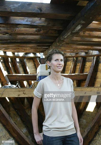 Syrian First Lady Asma alAssad listens on as she stands in the hull of a replica of a Phoenician ship being built on the Syrian island of Arwad some...
