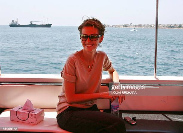 Syrian First Lady Asma alAssad sits on a boat during a visit to a workshop where a Phoenician ship is being built on the Syrian Island of Arwad off...