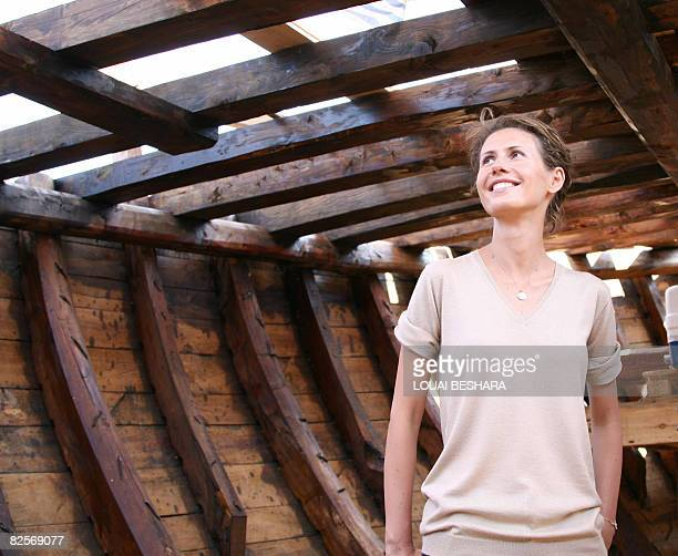 Syrian First Lady Asma alAssad stands in the hull of a replica of a Phoenician ship being built on the Syrian island of Arwad some 3 kms off the...