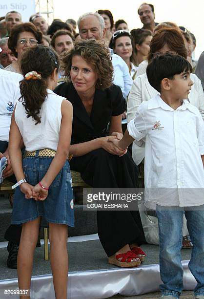 Syrian First Lady Asma alAssad talks to children attending the launching ceremony of a replica of a Phoenician ship built on the Syrian island of...