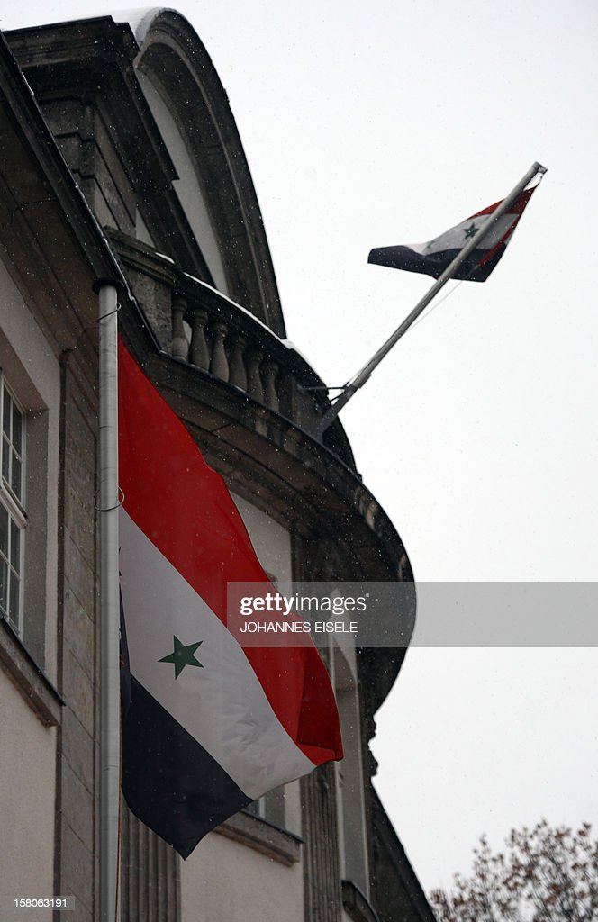 A Syrian flag flutters in front of the Embassy of Syria on December 10, 2012 in Berlin. Germany expelled four employees of the Syrian embassy in Berlin, the foreign minister said, as part of moves to further isolate the regime of Syrian President Bashar al-Assad.