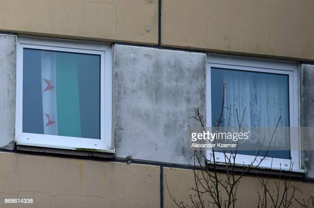 Syrian flag hangs in the window of an apartment police raided hours before and where they arrested a Syrian man on October 31 2017 in Schwerin...