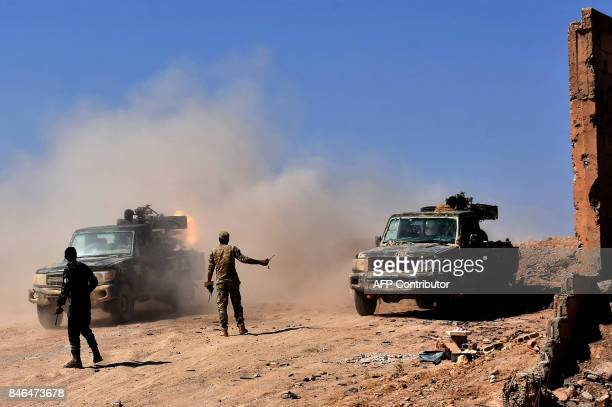 Syrian forces begin their advance on the area of Bughayliyah on the northern outskirts of Deir Ezzor on September 13 during their ongoing battle...