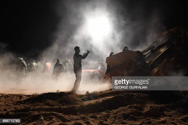 Syrian forces excavate a site said to be a mass grave by state news agency SANA west of Raqa province on December 29 2017 Two mass graves containing...