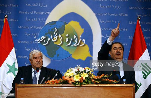Syrian Foreign Affairs Minister Walid Muallem looks on as his Iraqi counterpart Hoshyar Zebari gestures during a press conference after their meeting...