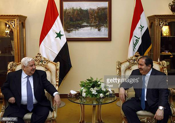 Syrian Foreign Affairs Minister Walid Muallem smiles with his Iraqi counterpart Hoshyar Zebari at Bagdhad Airport's VIP guest hall on March 25 2009...