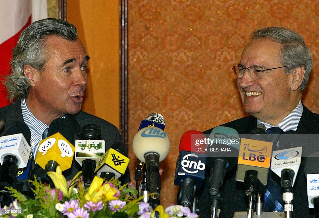 Syrian Foreign Minister Faruq al-Shara (R) and Canadian Foreign Minister Pierre Pettigrew (L) give a press conference in Damascus, 12 February 2005. Pierre Pettigrew is due to hold talks with Syrian authorities on the last leg of a Middle East tour.