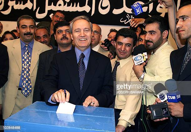 Syrian Foreign Minister Faruq alShara casts his vote for Bashar alAssad as the new Syrian president at a polling station in Damascus 10 July 2000...