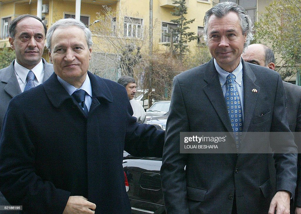 Syrian Foreign Minister Faruq al-Shara (L) receives Canadian Foreign Minister Pierre Pettigrew (R) in Damascus 12 February 2005 . Pierre Pettigrew is due to hold talks with Syrian authorities on the last leg of a Middle East tour.
