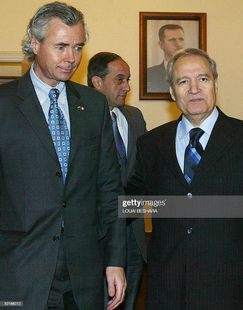 Syrian Foreign Minister Faruq al-Shara (R) receives Canadian Foreign Minister Pierre Pettigrew (L) in Damascus 12 February 2005. Pierre Pettigrew is due to hold talks with Syrian authorities on the last leg of a Middle East tour.
