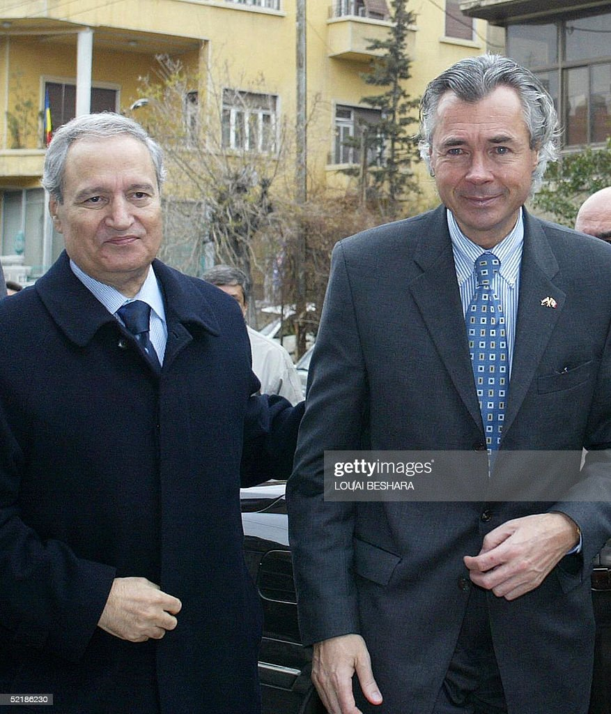 Syrian Foreign Minister Faruq al-Shara (L) receives Canadian Foreign Minister Pierre Pettigrew (R) in Damascus 12 February 2005. Pierre Pettigrew is due to hold talks with Syrian authorities on the last leg of a Middle East tour.