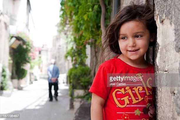 Syrian girl and neighborhood in Damascus