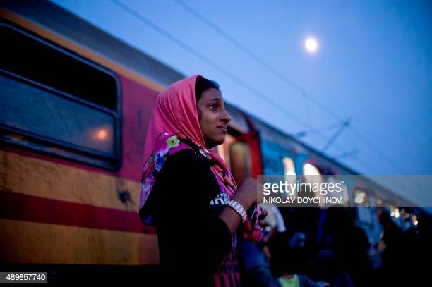Syrian girl cries after loosing site of her family while migrants and refugees board a train heading to Serbia near the Macedonian-Greek border on...