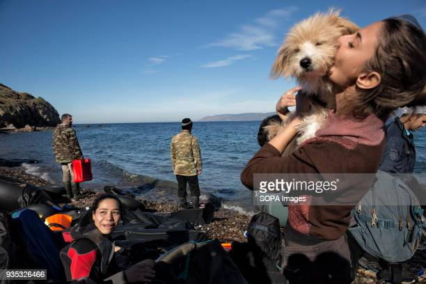 Syrian girl from Aleppo kisses her dog after she and her family arrived after crossing the Aegean Sea seeking asylum in Europe In 2015 more than a...