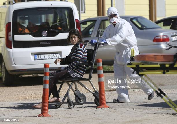 Syrian girl is being brought to Reyhanli State Hospital in Hatay Turkey on April 4 2017 Assad regime's suspected chlorine gas attack took place in...