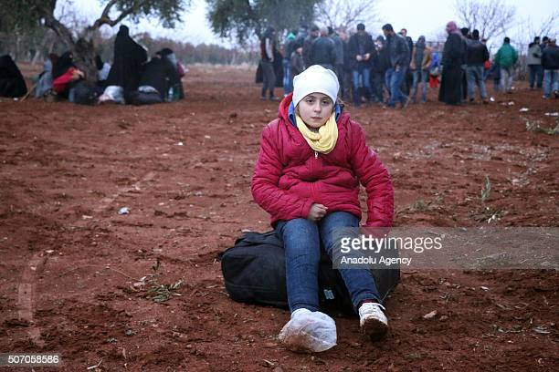 Syrian girl is seen during her journey to Turkish Syrian border because of the Russian and Assad Regime forces attacks in Aleppo Syria on January 27...