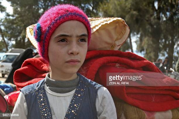 TOPSHOT Syrian girl Noor famous for broadcasting clips in English on social media about the regimebombardments on the former rebelheld town of Jobar...
