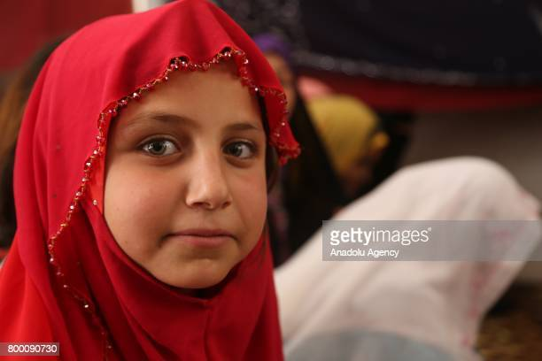 Syrian girl poses during Muslim's holy month of Ramadan in Idlib Syria on June 23 2017 Ahead of Eid al Fitr Syrian people who fled from their...