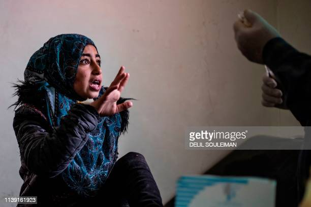Syrian girl reacts before getting injected with a treatment for leishmaniasis skin disease at a health centre in Karama, in northern Syria, about 26...