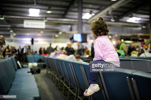 Syrian girl sits in the arrival hall after arriving with a group of other Syrian refugees at Hanover Airport on September 11 2013 in Hanover Germany...