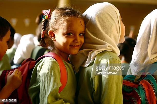 Syrian girls who fled the ongoing conflict in Syria stand in line at an all girls school in the south of Khartoum on September 19 2017 / AFP / ASHRAF...