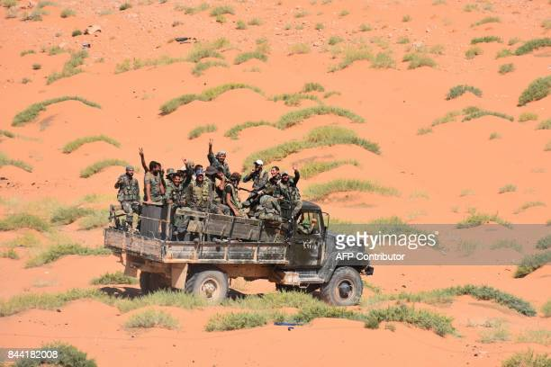 Syrian government forces advance in AlShula on the southwestern outskirts of Deir Ezzor on September 8 during the ongoing battle against Islamic...
