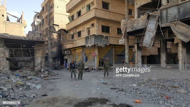 Syrian government forces are pictured in the eastern Syrian city of Deir Ezzor on November 3 2017 The Islamic State jihadist group lost control of...