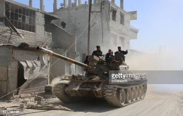 TOPSHOT Syrian government forces deploy in the captured town of Beit Sawa it the Eastern Ghouta region on the outskirts of Damascus on March 14 2018...