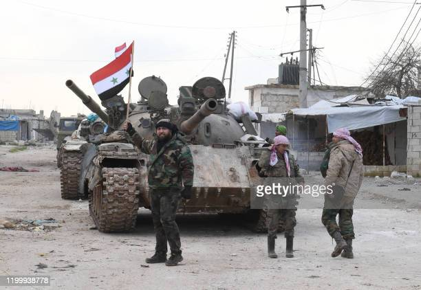 Syrian government forces deploy near the Damascus-Aleppo highway in the southern part of Syria's northern Aleppo province on February 10, 2020. -...