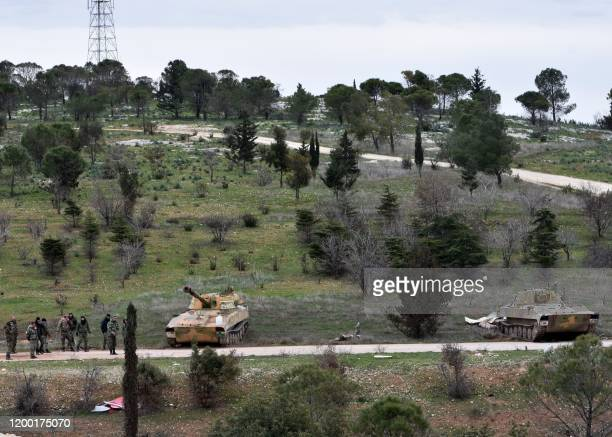 Syrian government forces gather after taking control of the Rashideen al-Rabea area in Syria's Aleppo province on February 11, 2020. - Syrian...