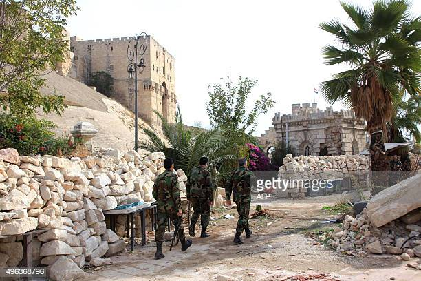 Syrian government forces hold a position near Aleppo's citadel on November 9 a few days after the army reportedly destroyed a tunnel used by rebels...