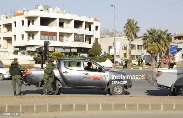 Syrian government forces man a checkpoint at the President square in Homs the country's third city on February 25 2017 as security measures were...