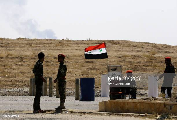 Syrian government forces man a checkpoint in the eastern Syrian city of Deir Ezzor on September 21 2017 as Syrian government forces continue to press...