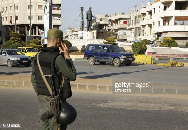 A Syrian government forces member mans a checkpoint at the President square in Homs the country's third city on February 25 2017 as security measures...