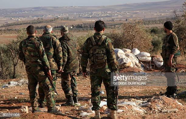 Syrian government forces monitor an area near the village of Khan Tuman south from the provincial capital Aleppo on December 22 two days after army...