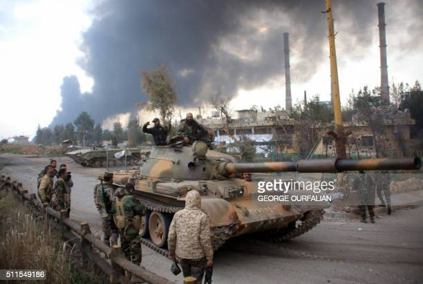Syrian government forces patrol near Aleppo's thermal power plant after they took control of the area on the eastern outskirts of Syria's northern...