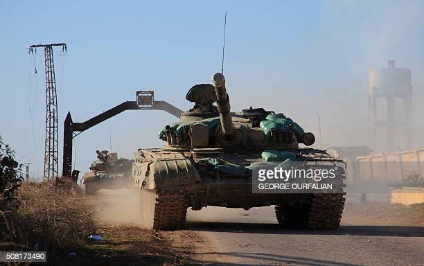 Syrian government forces' tanks drive in the village of Tal Jabin north of the embattled city of Aleppo as they advanced to break a threeyear rebel...