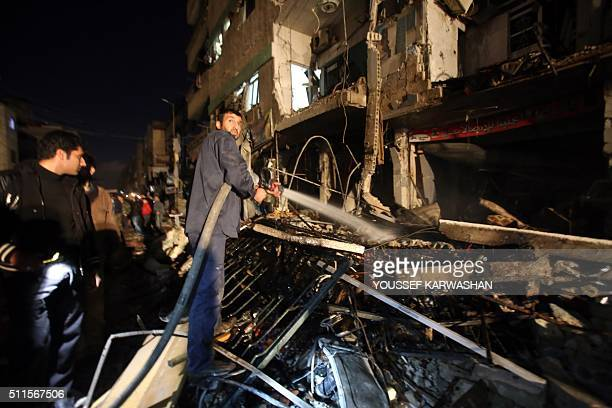 Syrian government security forces inspect the site of a series of attacks the area of the Sayyida Zeinab shrine south of Syria's capital Damascus on...