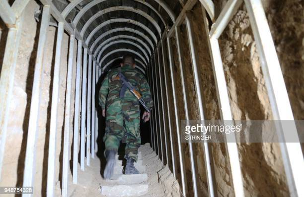 A Syrian government soldier walks in a tunnel leading to an abandoned prison used by Jaish alIslam fighters in the former rebelheld Syrian town of...