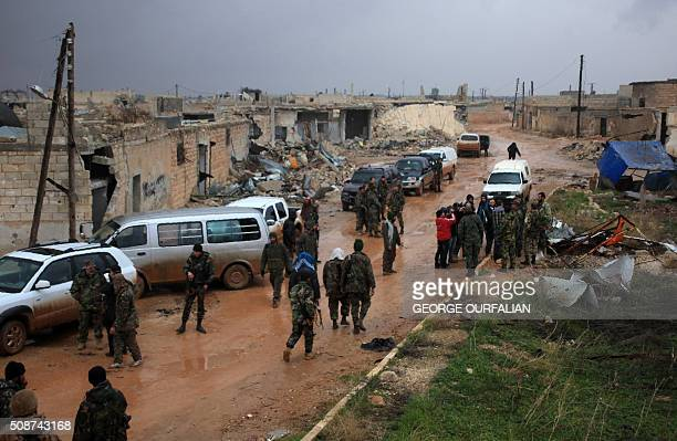 Syrian government soldiers regroup after taking control of the village of Ratian north of the embattled city of Aleppo from rebel fighters on...