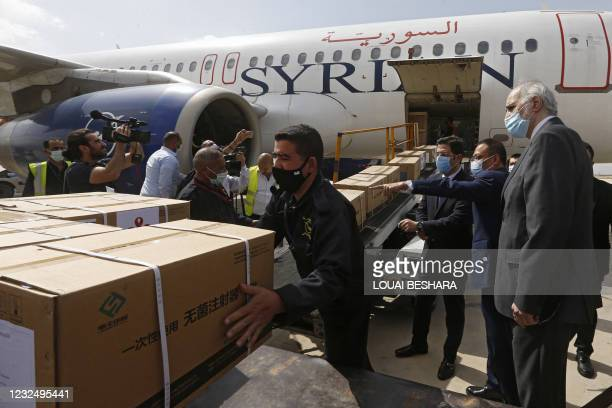 Syrian Health Minister Hassan al-Ghabash , Syrian Deputy Foreign Minister Bashar al-Jaafari and the Chinese Ambassador Feng Biao oversee the...