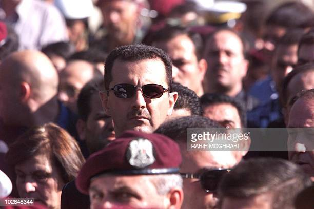 Syrian heir apparent Bashar alAssad marches behind the coffin of his father Syrian President Hafez alAssad during his funeral in Damascus 13 June...