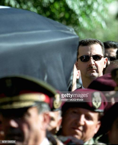 Syrian heir apparent Bashar alAssad marches behind the coffin of his father President Hafez alAssad during his funeral in Damascus 13 June 2000 Assad...