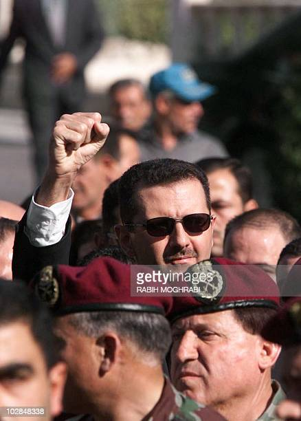 Syrian heir apparent Bashar alAssad raises his fist as he follows the funeral procession of his father President Hafez alAssad in Damascus 13 June...